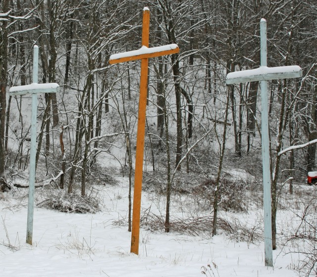 Three crosses in the snow