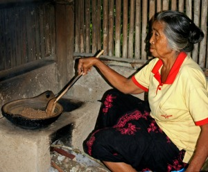 Woman roasting coffee beans
