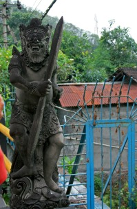 Bridge guardian on the road to the ashram