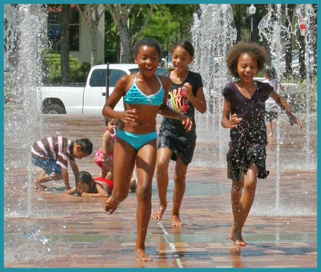 Running through water fountains