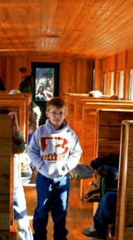 Boy inside caboose