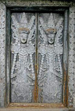 Silver figures on window, Bali