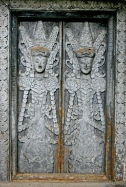 Silver figures on window, Bali