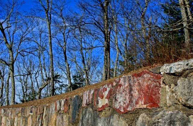 Red rock in stone wall