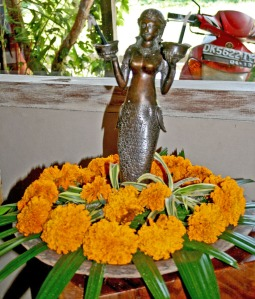 Goddess statue with marigolds