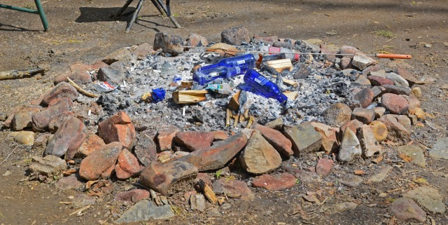 fire pit with empty bottles