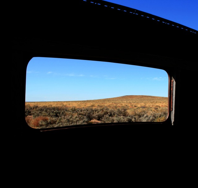 Window of car abandoned in desert