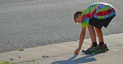 Boy picking up candy