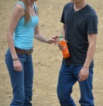 she returns the bottle to him