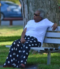 woman relaxing on park bench