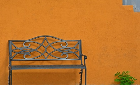 Bench against orange wall