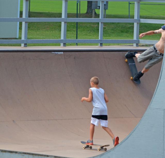 two boys skateboarding