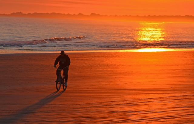 bike riding at sunset