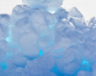 a pile of snow with blue lights