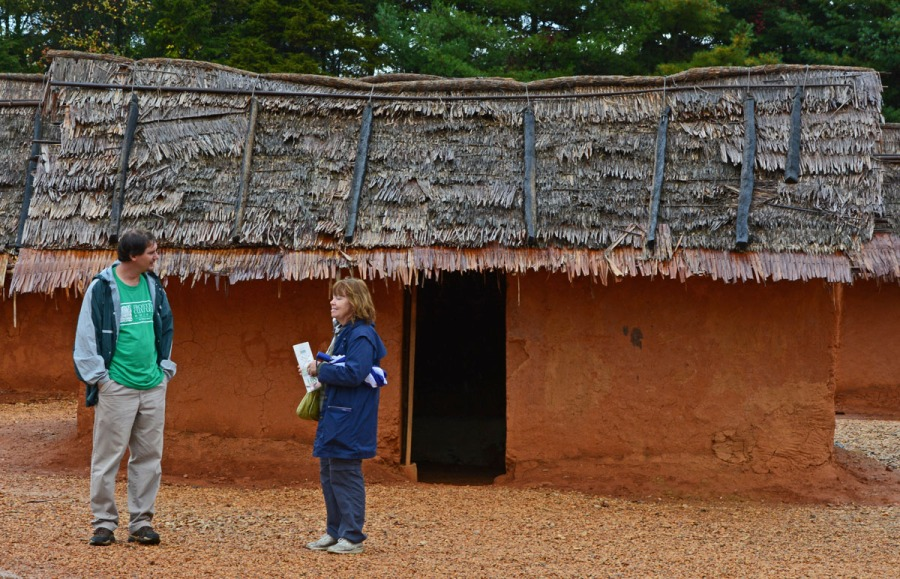 Visitor talking with staff person