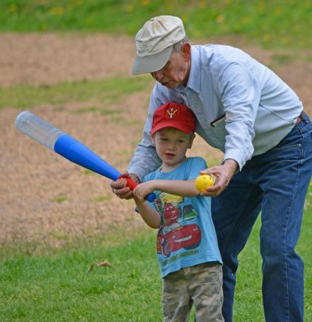 grandpa teaching grandson