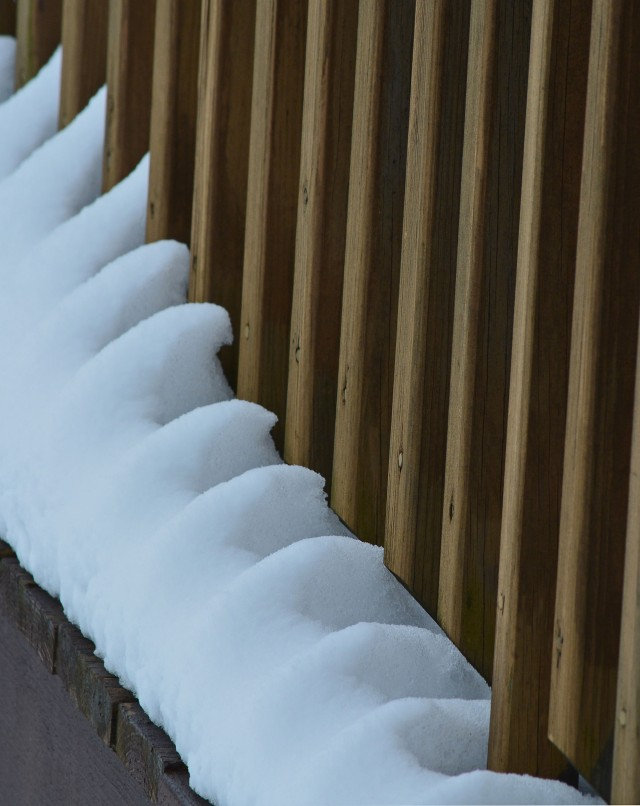 snow against railing